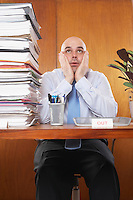 Overworked Businessman at Desk