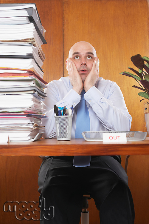 Overworked Businessman at Desk