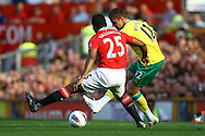 Picture by Paul Chesterton/Focus Images Ltd.  07904 640267.1/10/11.Antonio Valencia of Man Utd and Anthony Pilkington of Norwich in action during the Barclays Premier League match at Old Trafford Stadium, Manchester.
