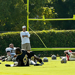 July 31, 2010; Metairie, LA, USA; New Orleans Saints head coach Sean Payton watches over his team during a training camp practice at the New Orleans Saints practice facility. Mandatory Credit: Derick E. Hingle