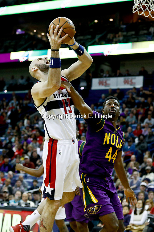 Jan 29, 2017; New Orleans, LA, USA; Washington Wizards center Marcin Gortat (13) shoots over New Orleans Pelicans forward Solomon Hill (44) during the second quarter of a game at the Smoothie King Center. Mandatory Credit: Derick E. Hingle-USA TODAY Sports