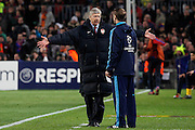 Arsenal's Arsene Wenger has words with the 4th referee Alain Bieri during the UEFA Champions League round of 16 second leg match between Barcelona and Arsenal on March 8, 2011 in Barcelona, Spain.