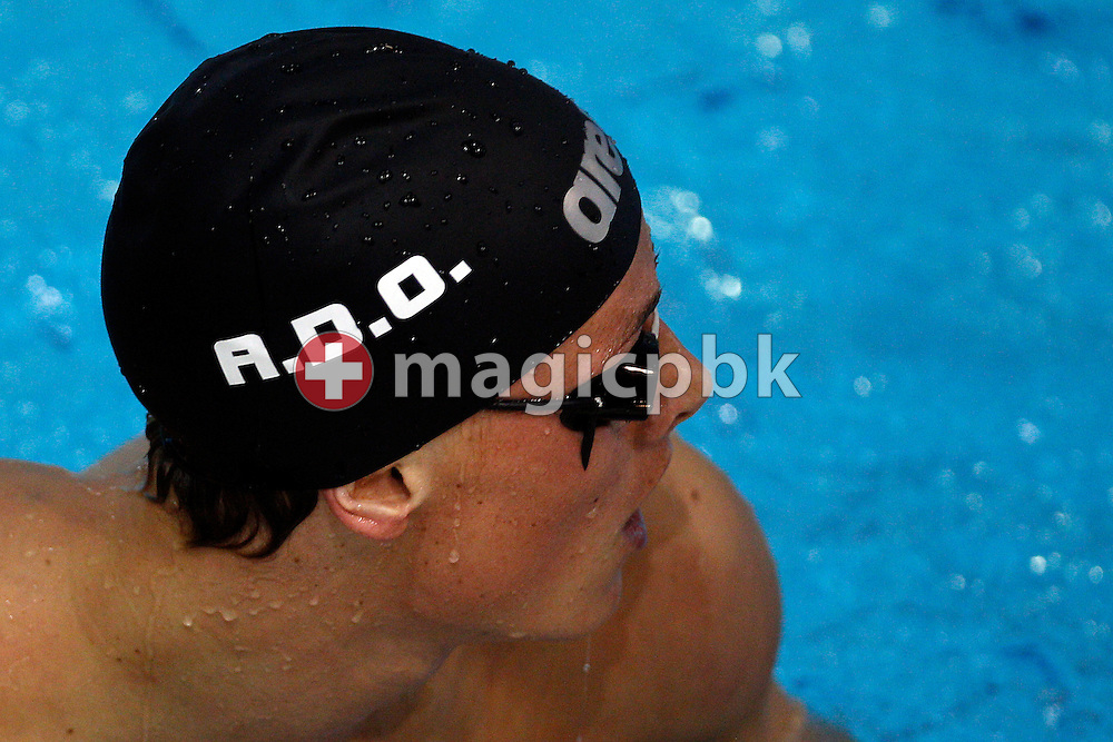 Lavrans Solli of Norway, who wears a swim cap with the initials of late team mate Alexander Dale Oen, looks back after competing in the men's 100m Backstroke Heats during the 31st LEN European Swimming Championships in Debrecen, Hungary, Monday, May 21, 2012. Dale Oen died three weeks ago of a heart attack in a training camp. (Photo by Patrick B. Kraemer / MAGICPBK)