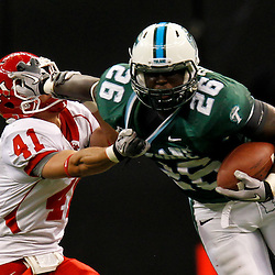 November 10, 2011; New Orleans, LA, USA; Tulane Green Wave running back Orleans Darkwa (26) stiff arms Houston Cougars defensive back Nick Saenz (41) during the second quarter at the Mercedes-Benz Superdome.  Mandatory Credit: Derick E. Hingle-US PRESSWIRE