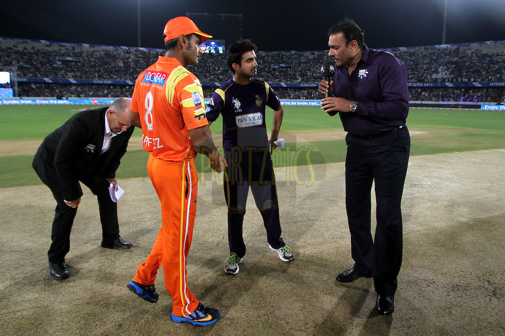 Kolkata Knight Riders  won the toss and chose the ball first during match 7 of the Oppo Champions League Twenty20 between the Kolkata Knight Riders and the Lahore Lions held at the Rajiv Gandhi Cricket Stadium, Hyderabad, India on the 21st September 2014<br /> <br /> Photo by:  Deepak Malik / Sportzpics/ CLT20<br /> <br /> <br /> Image use is subject to the terms and conditions as laid out by the BCCI/ CLT20.  The terms and conditions can be downloaded here:<br /> <br /> http://sportzpics.photoshelter.com/gallery/CLT20-Image-Terms-and-Conditions-2014/G0000IfNJn535VPU/C0000QhhKadWcjYs