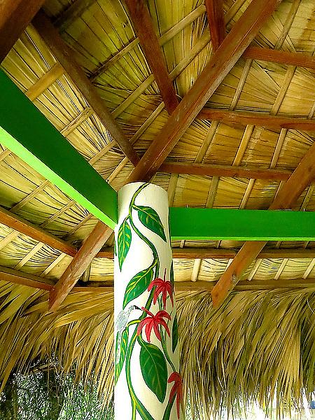 Palapa & painted post in Las Casas del Mar Neptunia, Las Terrenas, Dominican Republic.