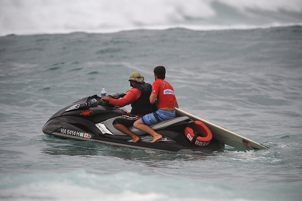 November 3rd  2010: Harley Ingleby taking advantage of jet ski assist during round 1 of the ASP World Longboard Championship at Makaha Oahu-Hawaii. Photo by Matt Roberts/mattrIMAGES.com.au
