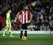 Brentford midfielder Alan Judge getting ready to take the penalty that he just won during the Sky Bet Championship match between Brentford and Huddersfield Town at Griffin Park, London, England on 19 December 2015. Photo by Matthew Redman.