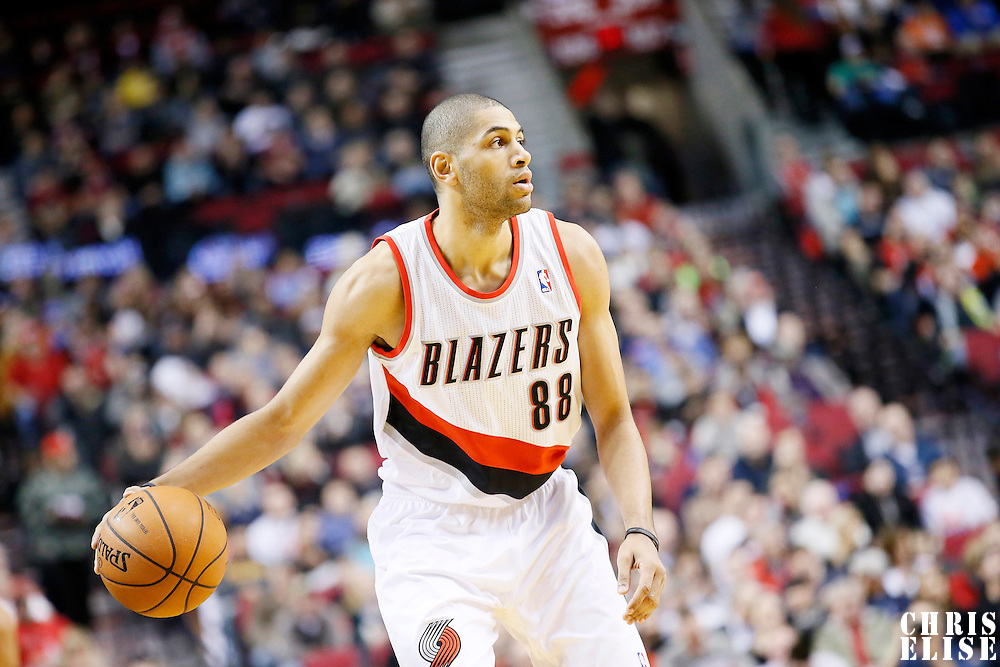 04 December 2013: Portland Trail Blazers small forward Nicolas Batum (88) looks to pass the ball during the Portland Trail Blazers 111-104 victory over the Oklahoma City Thunder at the Moda Center, Portland, Oregon, USA.