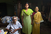 Mr. Arunachalam seated with his wife Lalitha and their grand daughter Vidya between them<br /> 2008<br /> Nagapattinam.
