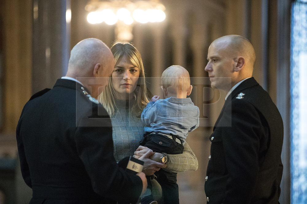 © Licensed to London News Pictures. 05/01/2018. Manchester, UK. Police officers and railway workers who came to the aid of victims in the wake of the terrorist attack at an Ariana Grande concert at the Manchester Arena in May 2017 are honoured at a commendation ceremony at Manchester Town Hall. Amongst those honoured are officers from British Transport Police and Northern Rail staff . Photo credit: Joel Goodman/LNP