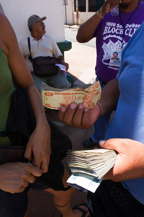 Changing dollars for Cordobas on the street in Granada, Nicaragua.