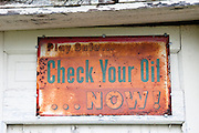 An old rusted sign along Route 66 reminding motorists to check their oil. Missoula Photographer