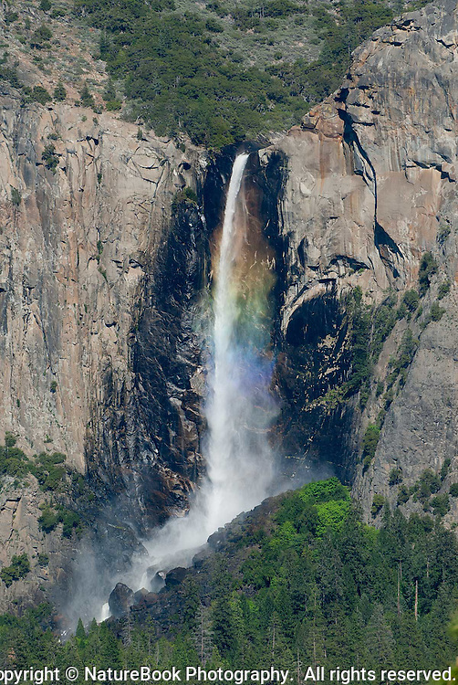 Bridalveil Fall at Yosemite National Park is one of the iconic locations in the park.  When the sun is in the right position, the spray from the falls breaks light down into colors.