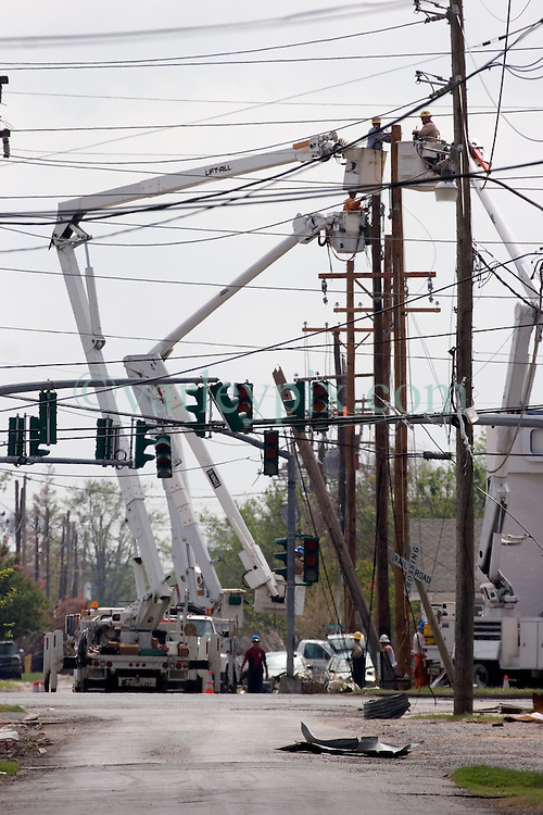 04 Oct, 2005. New Orleans, Louisiana. Hurricane Katrina aftermath.<br /> Private contractor telephone and power engineers work to restore services amidst the smashed homes in the Arabi neighbourhood. <br /> Photo; ©Charlie Varley/varleypix.com