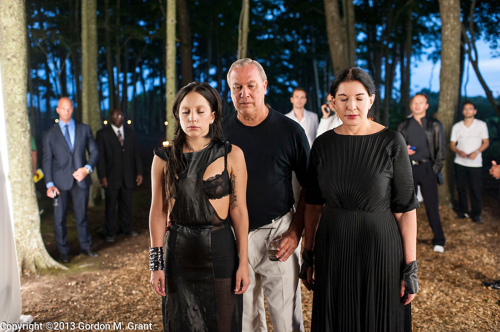 Water Mill, NY - 7/27/13 -  Lady Gaga, left, Robert Wilson, center, and Marina Abramovic, right, at an art installation at the 20th annual Watermill Center Summer Benefit in Water Mill, NY July 27, 2013. CREDIT: Gordon M. Grant for The Wall Street Journal<br /> NY.Devil'sHeaven