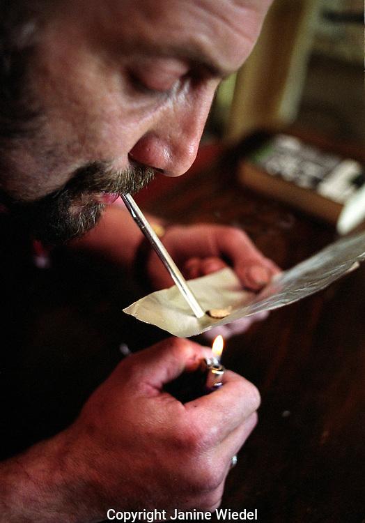 Heroin addict smoking brown.
