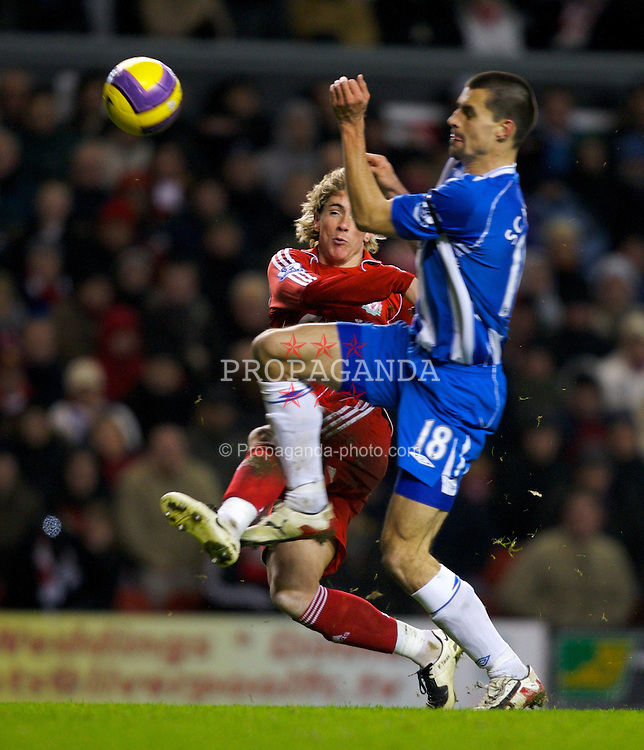 LIVERPOOL, ENGLAND - Wednesday, January 2, 2008: Liverpool's Fernando Torres is blocked by Wigan Athletic's Paul Scharner during the Premiership match at Anfield. (Photo by David Rawcliffe/Propaganda)