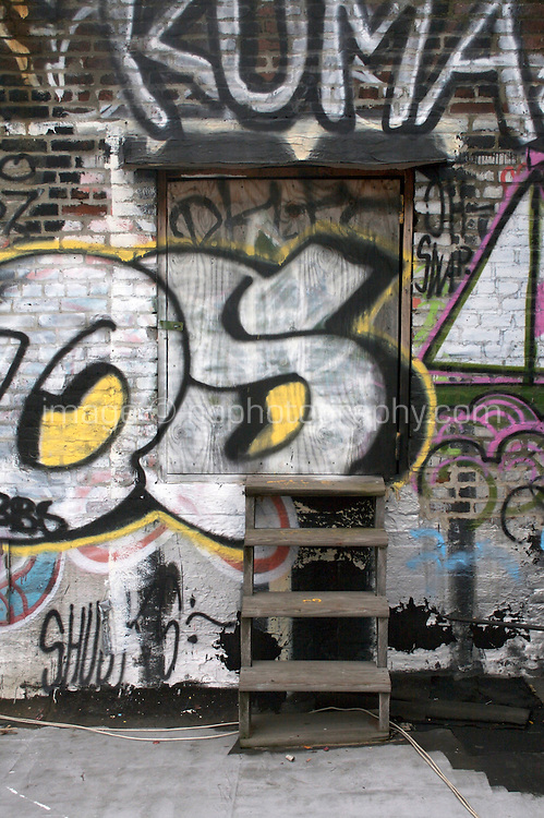 Grafitti covered rooftop wall in DUMBO Brooklyn New York