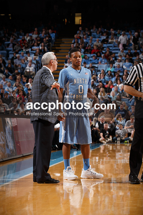 CHAPEL HILL, NC - DECEMBER 31: Nate Britt #0 of the North Carolina Tar Heels  talks to head coach Roy Williams while playing the UNC Wilmington Seahawks on December 31, 2013 at the Dean E. Smith Center in Chapel Hill, North Carolina. North Carolina defeated UNC Wilmington 84-51. (Photo by Peyton Williams/UNC/Getty Images) *** Local Caption *** Nate Britt;Roy Williams