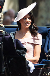 © Licensed to London News Pictures. 09/06/2018. London, UK. MEGHAN DUCHESS OF SUSSEX rides in a carriage to attend the Trooping The Colour ceremony in London. This years event is part of a weekend of celebration to mark the 92th birthday of Queen Elizabeth II, who is Britain's longest reigning monarch.Photo credit: Ray Tang/LNP