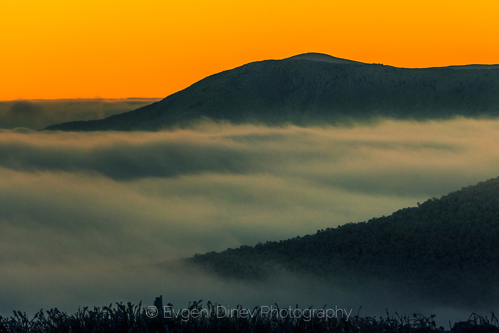 Mountain hills under the cover of clouds