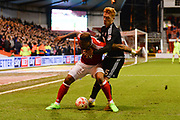 Nottingham Forest forward Britt Assombalonga (9) and Brentford midfielder Ryan Woods (15) during of the EFL Sky Bet Championship match between Nottingham Forest and Brentford at the City Ground, Nottingham, England on 7 March 2017. Photo by Jon Hobley.