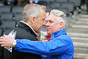 Scunthorpe United's interim manager Nick Daws and MK Dons Caretaker Manager Keith Millen greet each other before the EFL Sky Bet League 1 match between Milton Keynes Dons and Scunthorpe United at stadium:mk, Milton Keynes, England on 28 April 2018. Picture by Nigel Cole.