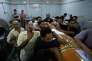 Egyptian Coptic Christians mourn as they prepare coffins to bury victims of sectarian violence October 10, 20011 at the Coptic Hospital in Cairo, Egypt. At least 26 people, mostly Christian, were killed during sectarian clashes that saw the worst violence since the Revolution that toppled former Egyptian president Hosni Mubarak earlier this year. Egyptian Coptic Christians make up about 10% of Egypt's 80 million population and periodically violence flares between the Christian minority and the majority Muslim population. (Photo by Scott Nelson)