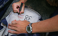 Luka Spik signing his bag, Member of Slovenian Rowing Olympic Team at departure to Beijing 2008 Olympic games, on July 31, 2008, at Airport Jozeta Pucnika, Brnik, Slovenia. (Photo by Vid Ponikvar / Sportal Images)/ Sportida)