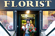 February 14, 2011 - A man walks out of Boston City Florist carrying flowers on Valentine's Day to be delivered.(Lathan Goumas)