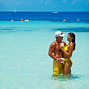 Couple romancing at the beach. Cancun, Quintana Roo. Mexico.