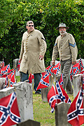 Confederate army re-enactors walk past grave markers during Confederate Memorial Day at Magnolia Cemetery May 11, 2019 in Charleston, South Carolina. Confederate memorial day continues to be an official state holiday in South Carolina where the American Civil War began.
