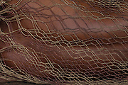 Huaorani Indian sleeping in hammock. These are made from fibres from the Chambira palm leaves.<br /> Bameno Community. Yasuni National Park.<br /> Amazon rainforest, ECUADOR.  South America<br /> This Indian tribe were basically uncontacted until 1956 when missionaries from the Summer Institute of Linguistics made contact with them. However there are still some groups from the tribe that remain uncontacted.  They are known as the Tagaeri & Taromenane. Traditionally these Indians were very hostile and killed many people who tried to enter into their territory. Their territory is in the Yasuni National Park which is now also being exploited for oil.