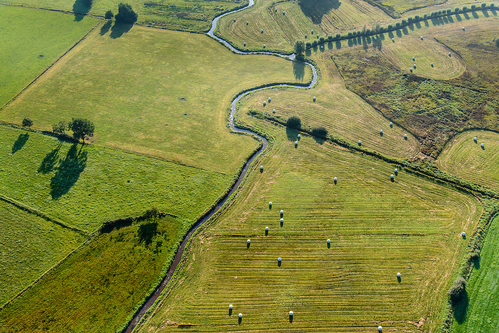 Nederland, Overijssel, Hardenberg, 28-10-2014; De Mulderij, Reestdal. Ggrasland met balen gemaaid gras en kronkelende beek, De Reest.<br /> Grassland with bales of cut grass and winding stream.<br /> luchtfoto (toeslag op standard tarieven);<br /> aerial photo (additional fee required);<br /> copyright foto/photo Siebe Swart