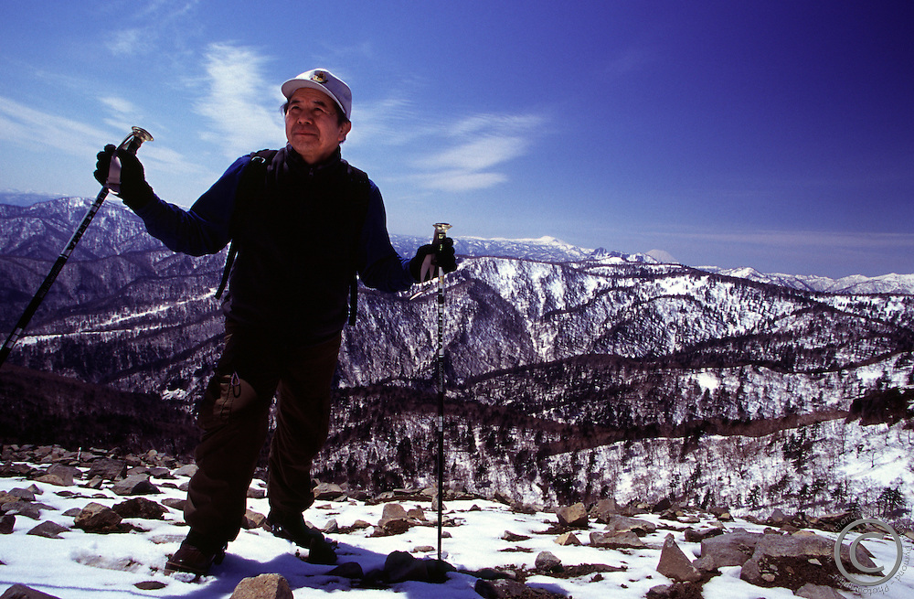 An elderly Japanese man on the summit of Mt Teine, a popular ski resort on the outskirts of Sapporo, Hokkaido, Japan