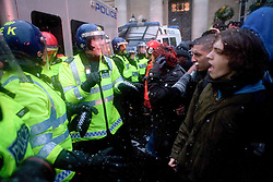 © Under license to London News Picures. Student square up to police in London today (30/11/2010) during a third day of protests against planned increases to tuition fees. Photo credit should read: Fuat Akyuz/London News Pictures