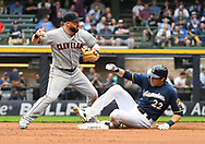 May 8, 2018 - Milwaukee, WI, U.S. - MILWAUKEE, WI - MAY 08: Milwaukee Brewers Outfield Christian Yelich (22) is out at 2nd as Cleveland Indians Second base Jason Kipnis (22) looks to throw to 1st during a MLB game between the Milwaukee Brewers and Cleveland Indians on May 8, 2018 at Miller Park in Milwaukee, WI.(Photo by Nick Wosika/Icon Sportswire) (Credit Image: © Nick Wosika/Icon SMI via ZUMA Press)