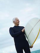 Senior Man with Surfboard