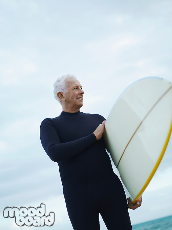 Senior Man with Surfboard