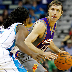 December 30, 2011; New Orleans, LA, USA; Phoenix Suns point guard Steve Nash (13) is guarded by New Orleans Hornets guard Carldell Johnson (5) during the a game at the New Orleans Arena. The Suns defeated the Hornets 93-78.   Mandatory Credit: Derick E. Hingle-US PRESSWIRE