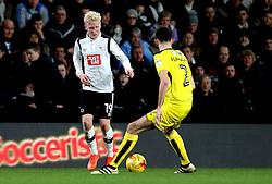 Will Hughes of Derby County takes on Tom Flanagan of Burton Albion - Mandatory by-line: Robbie Stephenson/JMP - 21/02/2017 - FOOTBALL - iPro Stadium - Derby, England - Derby County v Burton Albion - Sky Bet Championship