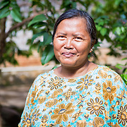 CAPTION: Dwi's mother, Maini, says she has noticed a few changes in her daughter's behaviour since learning about climate change at school. For example, she says she's been eager to install biopores around the house and that she has also started to make compost out of the family's organic waste. LOCATION: Dwi Wijayanti's house, Jl. St. Badaruddin II No 56, Bandar Lampung, Indonesia. INDIVIDUAL(S) PHOTOGRAPHED: Maini Wijayanti.