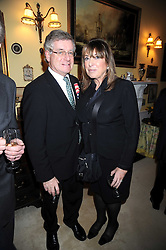 SIR NICHOLAS & LADY LLOYD at a birthday party for Lady Meyer hosted by Richard & Basia Briggs at their home 25 Sloane Gardens, London SW1 on 28th January 2009.