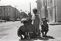 Group of neighborhood children playing and posing in the street San Franisco California.