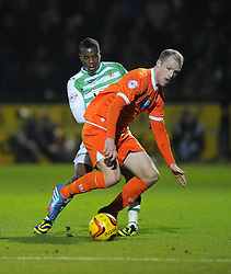 Yeovil Town's Joel Grant battles for the ball with Blackpool's Neil Bishop - Photo mandatory by-line: Joe Meredith/JMP - Tel: Mobile: 07966 386802 03/12/2013 - SPORT - Football - Yeovil - Huish Park - Yeovil Town v Blackpool - Sky Bet Championship