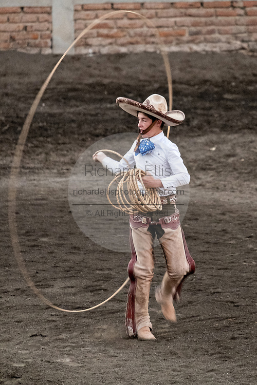 Juan Franco, Jr. practices his rope skills during the family Charreria practice session in the Jalisco Highlands town of Capilla de Guadalupe, Mexico. The Franco family has dominated Mexican rodeo for 40-years and has won three national championships, five second places and five third places.