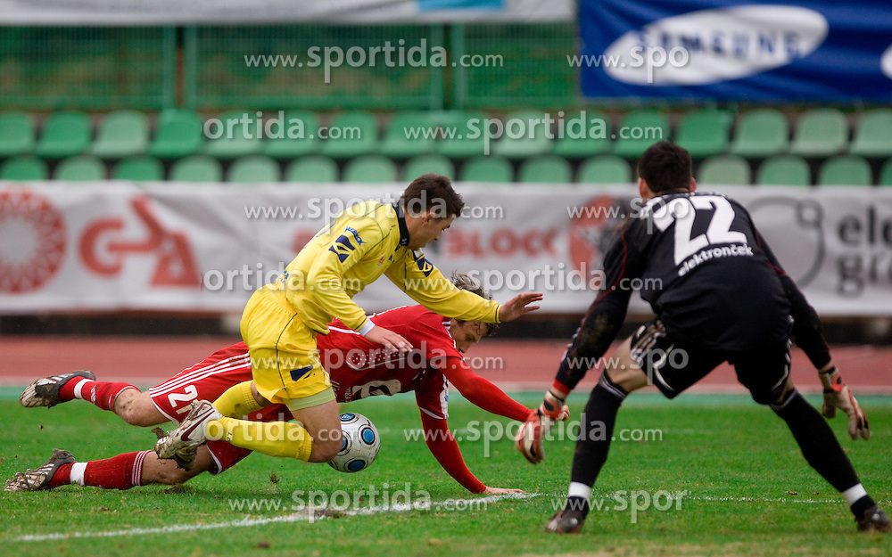 Tadej Apatic of Domzale, Benjamin David Gill of Interblock and Goalkeeper of Interblock Matjaz Rozman at  football match of 20th Round of First League between NK Interblock and NK Domzale, on December 5, 2009,  in ZSD Ljubljana, Ljubljana, Slovenia.  Interblock defeated Domzale 2:1. (Photo by Vid Ponikvar / Sportida)