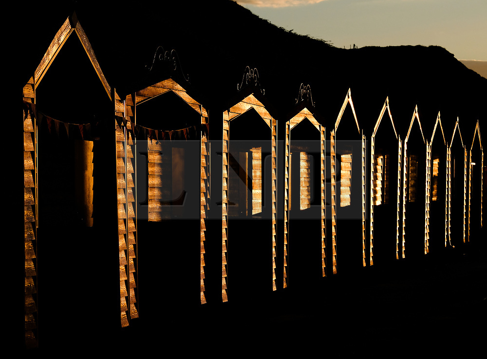 © Licensed to London News Pictures. <br /> 01/08/2017. <br /> Saltburn by the Sea, UK.  <br /> <br /> The light from the setting sun is reflected on beach huts on the promenade at Saltburn by the Sea.<br />   <br /> Photo credit: Ian Forsyth/LNP