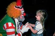Shrine Circus clown having conversation with preschooler age 3.  St Paul Minnesota USA